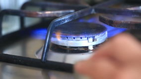 The igniting flame of the gas stove. close-up. Turn on the gas stove. The igniting flame of the gas stove. close-up stock footage