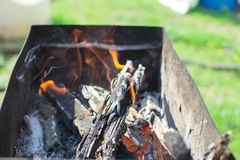 Ignition of the grill. Igniting the grill outdoors recreation weekend campfire cooking Stock Images