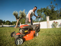 Igniting the lawnmower Stock Photos
