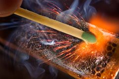 Igniting match Stock Images