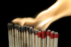 Igniting matchs. A row of matchs in the process of igniting Royalty Free Stock Images
