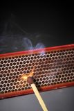 Ignition. Striking a match against a match box Royalty Free Stock Images