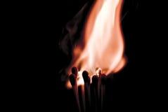 Ignition. Set of burning matches on black background Stock Image