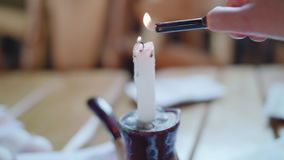 Ignition candle with lighter in light room