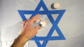 Ignition of candles, flag of Israel stock video