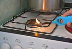 Ignition of the gas appliance by the lighter and hand. Ignition of the gas appliance by the lighter Stock Photos