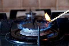 Ignition of a gas ring on the stove. Ignition by a match of a gas ring on the stove Stock Photos