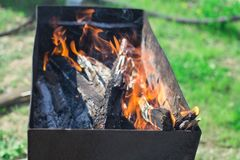 Ignition of the grill. Igniting the grill outdoors recreation weekend campfire cooking Royalty Free Stock Photo