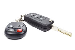 Ignition key and garage door remote control on a white backgroun Stock Photo