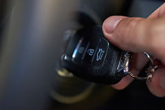 Ignition key in hand. Try to start car close up Royalty Free Stock Photos