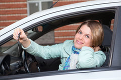 Ignition key in hand of woman in car Royalty Free Stock Image