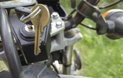 Ignition key in a motorcycle standing on a trail stock images
