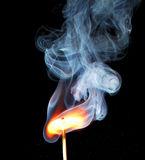 Ignition of match. With smoke on black Stock Photos