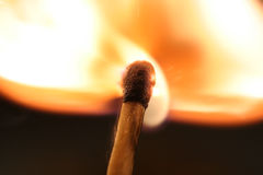 Ignition of a match. On a dark background royalty free stock photography