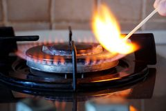 Ignition of a gas ring on the stove. Ignition by a match of a gas ring on the stove Royalty Free Stock Photos