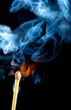 Ignition of match with smoke Royalty Free Stock Photos