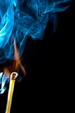 Ignition of match with smoke Stock Images