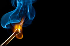 Ignition of match with smoke Stock Photography