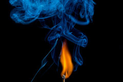 Ignition of match with smoke Royalty Free Stock Photo
