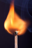 Ignition of a match, with smoke on dark background Stock Image