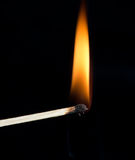 Ignition of a match. With smoke on dark background Stock Images