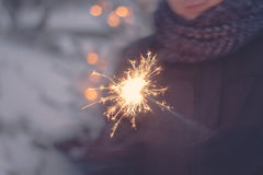 Ignition. Of a sparkler in winter Royalty Free Stock Photos