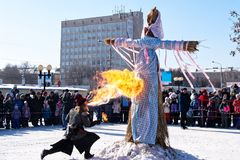 Ignition of stuffed for the winter Slavic holiday Maslenitsa. Magnitogorsk. Russia. 17th of February 2018 stock photography