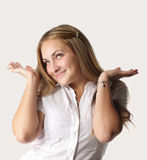 Ignorance. Fair hair girl in white shirt showing ignorance gesture Royalty Free Stock Photo