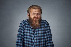 Ignorance arrogance. Man shrugging shoulders who cares so what. Ignorance and arrogance. Young bearded man shrugging shoulders who cares so what. Hipster male stock photos