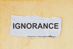 Ignorance lack of knowledge. Newspaper cutout in an old paper background Stock Photography