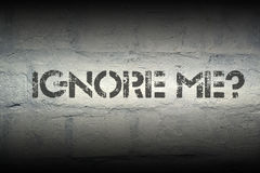 Ignore me. Question stencil print on the grunge white brick wall Royalty Free Stock Photos