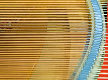 Igold strings inside of a piano Royalty Free Stock Photos