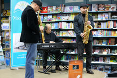 Igor Bril and his sons saxophonists play music Stock Images