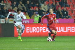 Igors Tarasovs and Tomas Rosicky. Prague 28/03/2015 _ Match of EURO 2016 qualification group A Czech Republic - Latvia 1:1 (0:1). Goals 90' Pilař - 30' Viš royalty free stock images