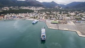 Aerial drone image of Igoumenitsa port in Greece and vessels loading/unloading. IGOUMENITSA / GREECE- JANUARY 15, 2017: Aerial drone image of Igoumenitsa port Royalty Free Stock Photo
