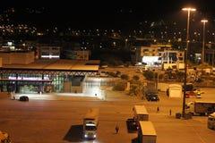 Igoumenitsa port, Greece, at night. Lorries and port flourescent sign and tall lights stock images