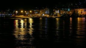 Igoumenitsa sea port at night, Greece. View from a ferryboat traveling to Corfu Island.  stock footage