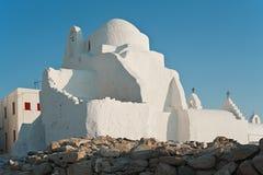 Igreja de Panagia Paraportiani em Mykonos, Grécia no por do sol Imagem de Stock