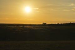 Igreja distante da paisagem do por do sol Imagens de Stock Royalty Free