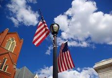 Igreja e bandeiras. fotografia de stock