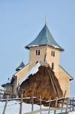 Igreja e feno em Romania Fotos de Stock