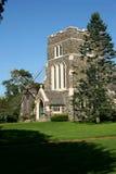 Igreja e o moinho de vento Fotos de Stock Royalty Free