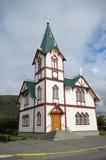 A igreja no porto de Husavik em Islândia Fotografia de Stock