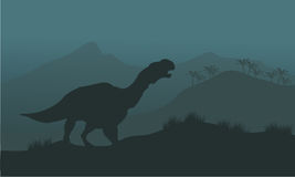 Iguanodon dinosaurs silhouette Stock Images