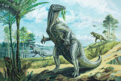Iguanodon. A large herbivorous dinosaur with characteristic spiked thumbs. Length about 30 ft 9 m. Background: Megalosaurus. Lower Cretaceous, about 120 million Stock Photography
