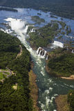 Aerial view of Iguassu Falls taken from a helicopter. Iguassu Falls is the largest series of waterfalls on the planet, located in Brazil, Argentina, and royalty free stock photos