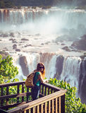 Iguassu falls. Traveler girl and view of worldwide known Iguassu falls at the border of Brazil and Argentina stock images