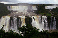 Iguassu Falls in Winter. A winter view of Iguassu Falls with a near record amount of water flowing over the falls stock photography