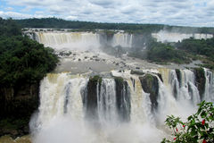 Iguassu waterfalls. Iguazu Falls, Iguassu Falls, Cataratas do Iguaçu, Cataratas del Iguazu. Waterfalls of the Iguazu River on the border of the Argentina Royalty Free Stock Photography