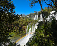 Iguasu Falls, Argentina Brazil. MW - A rainbow forms in the spray from the Iguasu Falls Stock Images